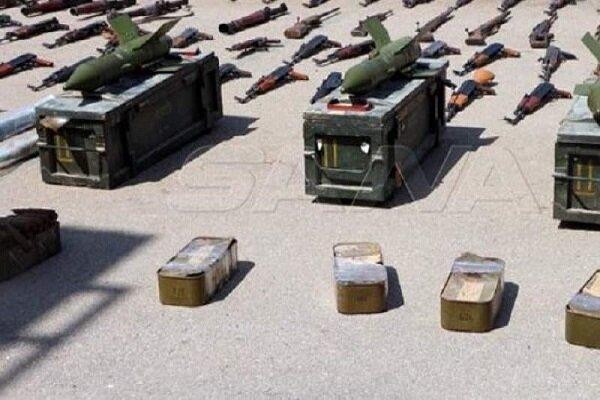 کشف مقادیری سلاح و مهمات برجای مانده از تروریستها در غرب درعا